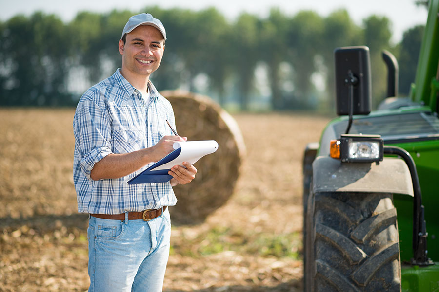 Business Insurance - Farmer Taking Notes On Field