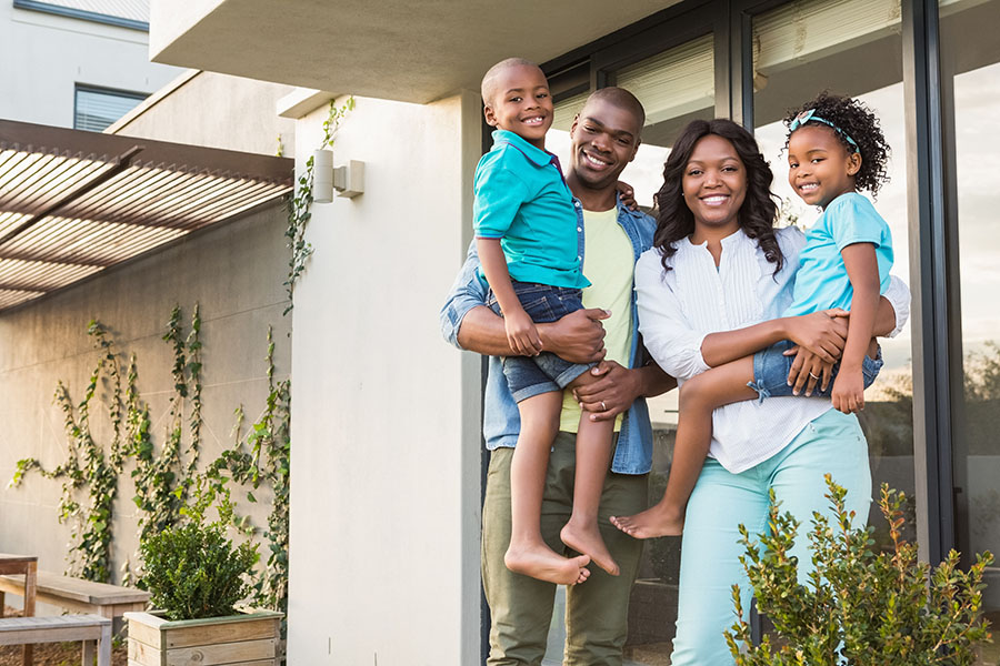 Personal Insurance - Happy Family Standing Next To Home